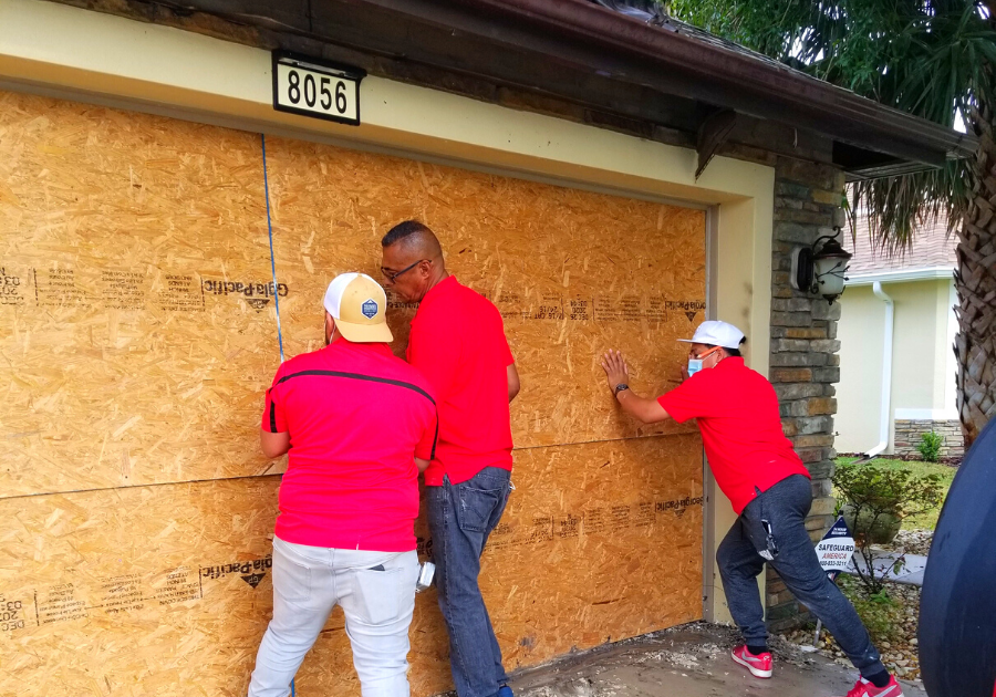 Pro Master team boarding up a house after fire damage in Kissimmee